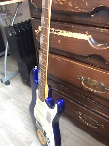 Electric fender guitar and squire amp