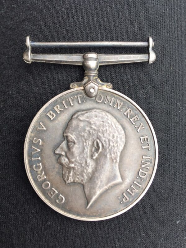 WWI BRITISH WAR SILVER MEDAL GEORGIVS V BRITT. OMN REX ET IND IMP 1914-1918