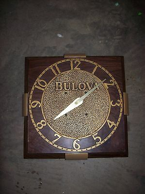 Bulova wood grained wall clock
