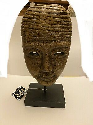 Head Mask On Wooden Base
