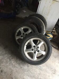 2 Mazda protege rims and tires