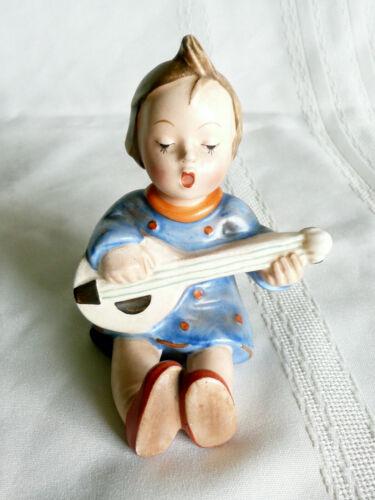 M J Hummel Girl with Instrument Figurine    Germany