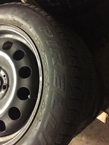 4 winter Pirelli 175/65/15 on rims 4x100  Kitchener / Waterloo Kitchener Area image 2
