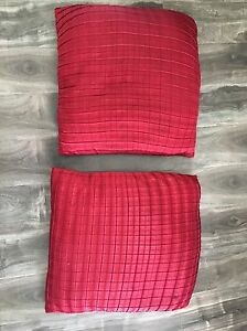 2 matching red silk pillows