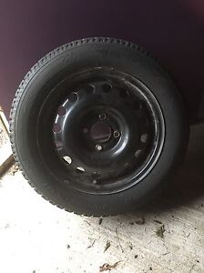 Two snow tires with rims 195/60/R15  2005 Ford Focus. London Ontario image 1