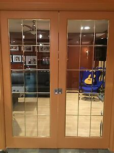 French Pocket Doors w/ bevelled glass and bass inserts