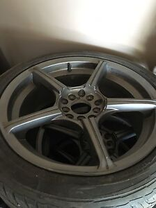 Set of 17x7 rims with tires 215 45 17