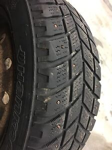3 used studded tires $75 205/55R16