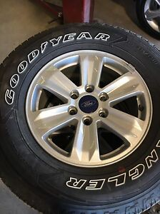 """Brand new Good Year 17"""" factory tires AND rims"""