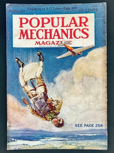 1928 Popular Mechanics Cover: Parachute, squirrel suit glide pants, biplane