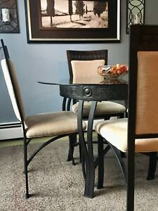 Wrought iron 4-seat table with glass