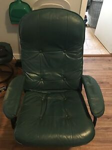 Green leather reclining chair with foot rest