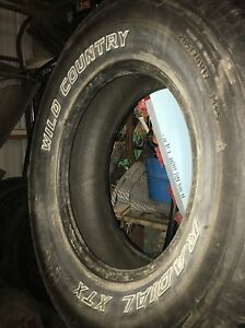 4  GOOD USED 265  70 r17 WILD COUNTRY  XTX TIRES or swap