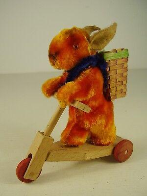 Antiker seltener Osterhase auf Holz Roller