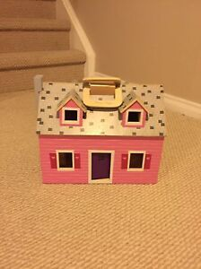 Carry and go wooden doll house