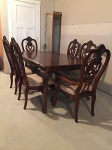Beautiful solid wood table and chairs.