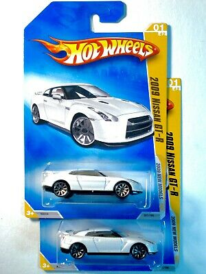 2 HOT WHEELS 2009 NISSAN GT-R from 2009 NEW MODELS...WHITE, BOTH 10 SPOKES