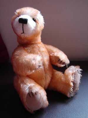 "Gorgeous Character bear by Canterbury bears. Double neck joint. 11"" tall."