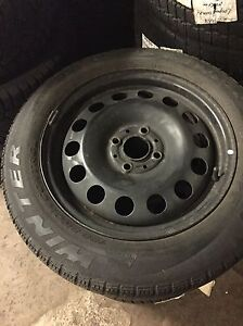 4 winter Pirelli 175/65/15 on rims 4x100  Kitchener / Waterloo Kitchener Area image 1