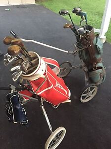 Two Vintage set of golf clubs and carts