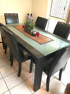 Black glass table and leather chairs Lutwyche Brisbane North East Preview