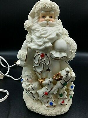 Ceramic Santa with Snowman Reindeer and Sleigh Cut out Stars Lights Up Electric