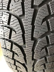 Like new 235 60 18 winter tires