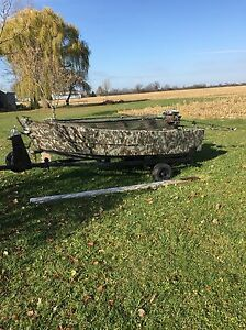 12ft steel boat with 6hp mud motor & trailer.
