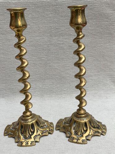Lovely pair of heavy brass twist stem candlesticks ornate bases
