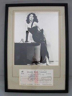 AVA GARDNER SIGNED CHEQUE WITH SULTRY PHOTOGRAPH IN FRAME