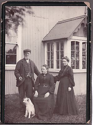 VINTAGE 1890'S-1910 FAMILY POSE FREAK LOOKING TERRIER DOG FASHION OF ERA PHOTO