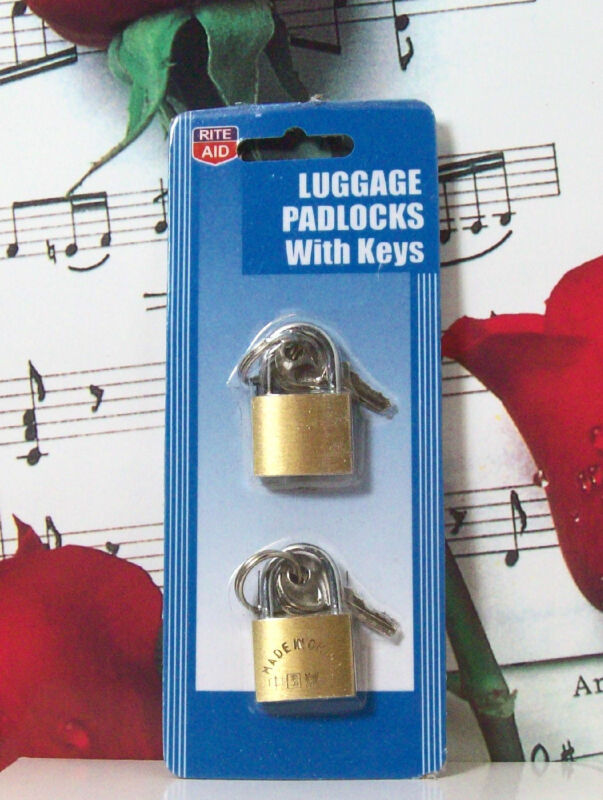 "2 small 1 1/4"" luggage padlocks with keys by Rite Aid"