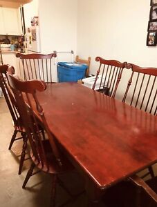 antique dining table sold wood in good condition 6 chairs.