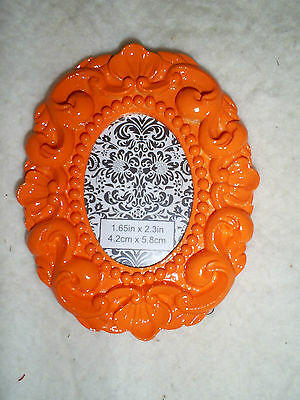 3.75 Tall X 3 Wide Oval Orange Resin Easel Back Table Top Photo Frame