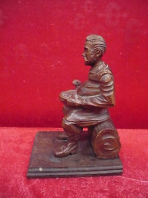 Beautiful, antique wooden figure__Seated Man ___