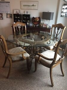 Round wrought iron glass table and 4 chairs