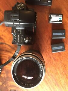 Sony A55 and 3 batteries and charger and zoom lens