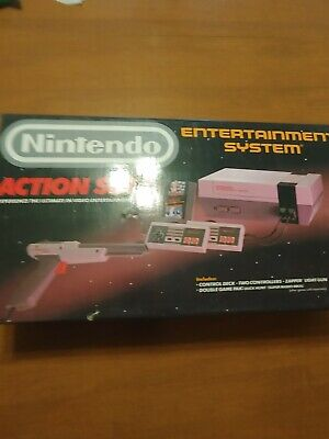 Nintendo NES Action Set with packaging and plastic. Working
