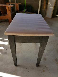 Padded black wooden stool