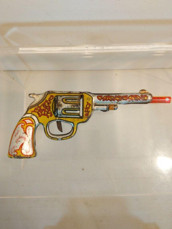 VINTAGE PRESSED STEEL TOY CLICKER GUN