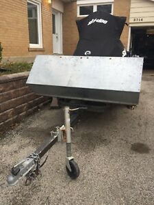 Solid snowmobile/utility trailer