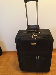 Valise Travelpro grand format.