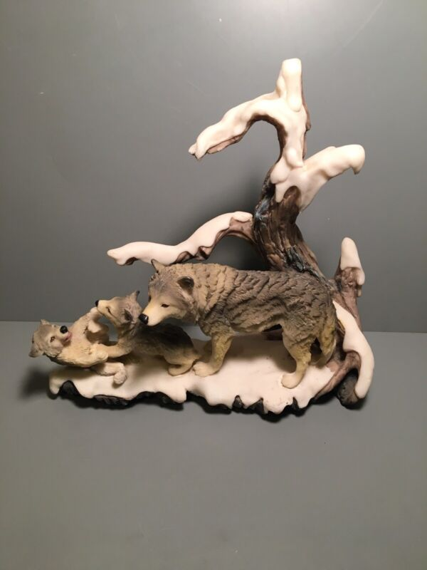 Snowy Wolf And Pups Statue