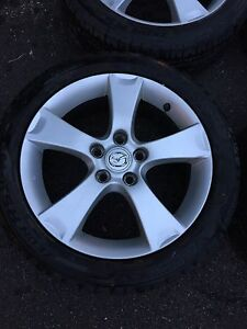 17 in. Cooper summer tires on Mazda rims
