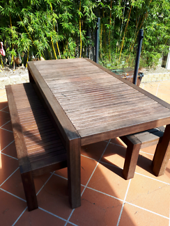 Teak outdoor dining table and benches