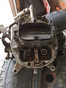 Four barrel Ford carburetor & Staggered shock plates