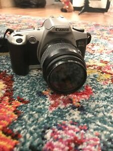 Canon Rebel G 1996 with tripod. Great condition!
