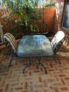 Outdoor glass table   two cushion chairs