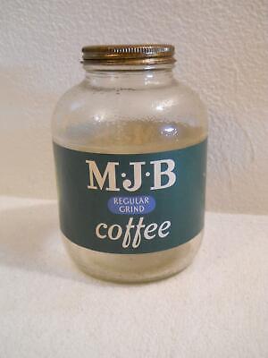 A VINTAGE MJB COFFEE ONE POUND GLASS JAR WITH LABEL