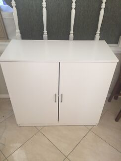 White laundry cupboard